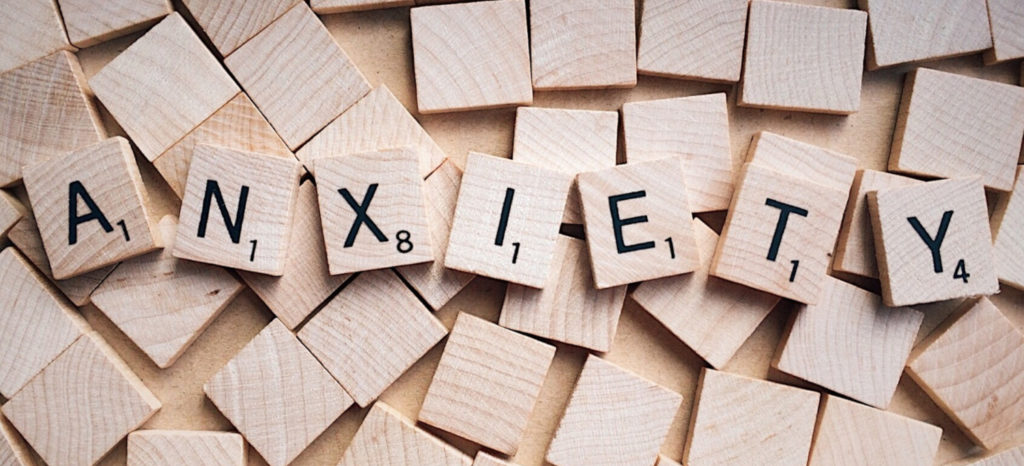 "The word ""anxiety"" spelled out with Scrabble tiles"